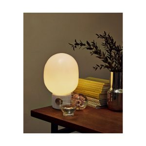 Lifestyle Photo of JWDA Concrete and Brass Table Lamp Turned On